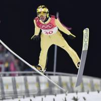 Noriaki Kasai takes his second jump during the men's normal hill final at the Pyeongchang Olympics on Saturday.  Kasai finished 21st. | KYODO