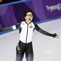 Nao Kodaira reacts after setting an Olympic record time of 36.94 seconds in the women's 500 meters at Gangneung Oval on Sunday night. Kodaira claimed the gold medal. | REUTERS