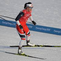 Norway's Marit Bjoergen competes in the women's team sprint freestyle cross-country skiing semifinals on Wednesday at the Pyeongchang Olympics. She collected a bronze, her record-breaking 14th Winter Games medal. | AP