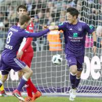 Ryota Morioka (right) celebrates after scoring for Anderlecht against Mouscron in the Belgian league on Sunday. | KYODO