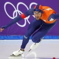The Netherlands' Kjeld Nuis races to victory in the men's 1,500 meters on Tuesday in Gangneung, South Korea. | REUTERS