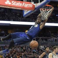 The Magic's Jonathon Simmons hangs from the rim after a dunk during Orlando's 116-98 win over the Cavaliers on Tuesday. | AP