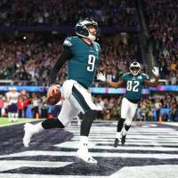 Eagles quarterback Nick Foles begins to celebrate after catching a touchdown pass during the second quarter of Super Bowl LII on Sunday in Minneapolis. | USA TODAY / VIA REUTERS