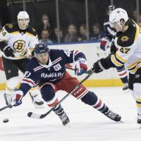Streaking Bruins overwhelm Rangers for 18th win in 23 games