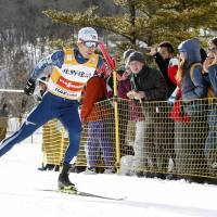 Akito Watabe competes on his way to winning a Nordic combined World Cup event in Hakuba, Nagano Prefecture, on Saturday. | KYODO