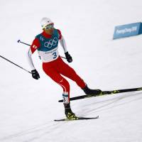 Akito Watabe competes in the Nordic combined men's individual normal hill 10-km  cross-country event at the Alpensia Cross-Country Centre on Wednesday. Watabe earned the silver medal. | REUTERS