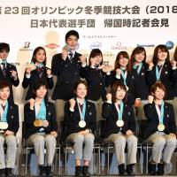 Japan's Olympic medal-winning athletes show off their prizes after a news conference in Tokyo on Monday. | YOSHIAKI MIURA