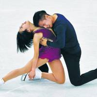 China's Sui Wenjing and Han Cong perform their short program in the pairs figure skating competition at the Pyeongchang Olympics on Wednesday. | AFP-JIJI