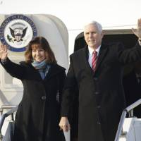 U.S. Vice President Mike Pence and his wife Karen wave after arriving at Osan Air Base in Pyeongtaek, South Korea on Thursday. | BLOOMBERG