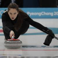 Olympic Athlete of Russia Anastasia Bryzgalova practices for the Olympic mixed doubles curling competition on Wednesday in Gangneung, South Korea. | AP