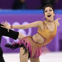 Japan advances in team competition