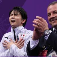 Yuzuru Hanyu reacts after hearing his score for Saturday's free skate. | REUTERS