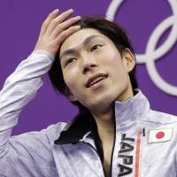 Keiji Tanaka reacts to his performance in the short program on Friday. Tanaka finished the day in 20th place. | AP