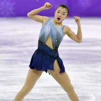 Kaori Sakamoto skates at the Pyeongchang Games on Wednesday. She's in fifth place after the short program. | KYODO
