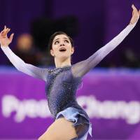 Evgenia Medvedeva of the Olympic Athletes from Russia performs her short program at the Pyeongchang Olympics on Wednesday. | REUTERS