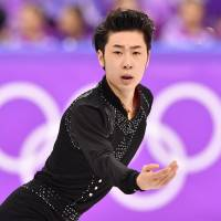 China's Jin Boyang competes in the men's single skating short program of the figure skating event at the Gangneung Ice Arena on Friday. | AFP-JIJI
