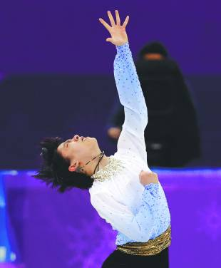Yuzuru Hanyu performs his short program during the men's figure skating competition at the Pyeongchang Olympics on Friday in Gangneung, South Korea.