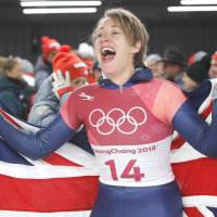 Lizzy Yarnold celebrates winning the gold medal in women's skeleton on Sunday in Pyeongchang, South Korea.   REUTERS