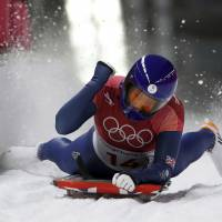 Britain's Lizzy Yarnold celebrates her winning run in the women's skeleton competition at the Pyeongchang Olympics on Saturday.   AP