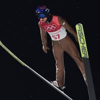 Poland's Kamil Stoch competes in the men's large hill individual ski jumping qualifying event on Saturday. Stoch captured the gold medal. | AFP-JIJI