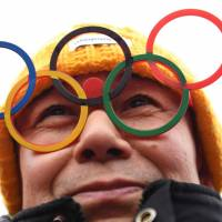 A spectator waits for the start of the women's slalom at Jeongseon Alpine Centre in Pyeongchang, South Korea, on Wednesday. | AFP-JIJI
