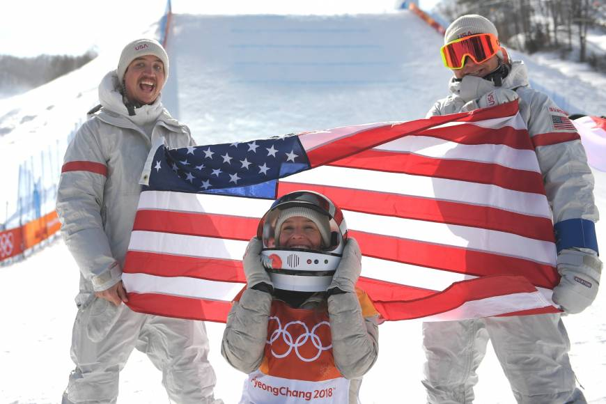 Jamie Anderson (center) celebrates after winning the women