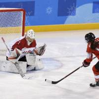 Switzerland's Evelina Raselli of Switzerland scores early in the first period against Japan's Nana Fujimoto at Kwandong Hockey Centre on Tuesday. Switzerland defeated Japan 1-0. | REUTERS