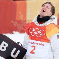 Shaun White of the United States celebrates after winning his third Olympic halfpipe title on Wednesday in Pyeongchang, South Korea. | REUTERS