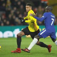 Watford's Etienne Capoue (left) moves past Chelsea's N'Golo Kante during their match on Monday in Watford, England. | REUTERS