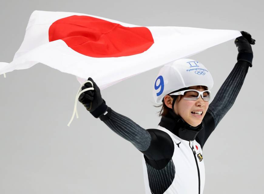 Nana Takagi celebrates after capturing the gold medal in the women
