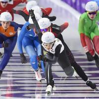 Nana Takagi races at the front of the pack in the women's mass start competition on Saturday night. | KYODO