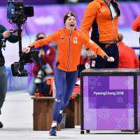 The Netherlands' Esmee Visser celebrates winning the gold medal in the women's 5,000-meter event at the Pyeongchang Olympics on Friday. | AFP-JIJI