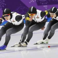 Japan's Miho Takagi (left), Ayano Sato (center) and Nana Takagi race in the women's team pursuit final on Wednesday en route to a gold medal. | KYODO