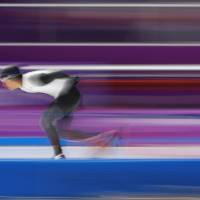 Ryosuke Tsuchiya of Japan competes Sunday in the 5,000-meter speedskating event at the Pyeongchang Games in South Korea. | REUTERS