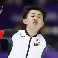 Japan's Seitaro Ichinohe celebrates after the men's 5,000 meters race at the Gangneung Oval at the 2018 Winter Olympics in Gangneung, South Korea, Sunday. | AP