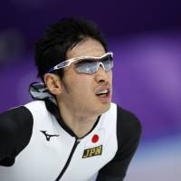 Japan's Ryosuke Tsuchiya catches his breath after the men's 5,000 meters race at the Gangneung Oval at the 2018 Winter Olympics in Gangneung, South Korea, Sunday. | AP