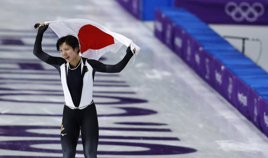Silver medallist Miho Takagi of Japan holds the national flag after the women