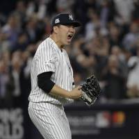 New York's Masahiro Tanaka reacts after striking out Houston's Josh Reddick in Game 5 of the American League Championship Series on Oct. 18, 2017. | AP
