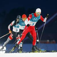 Akito Watabe captured silver for Japan in the Nordic combined men's individual normal hill 10-km competition for the second straight games. | REUTERS