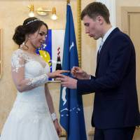 Russian freestyle skier Semen Denshchikov, who will compete at the Pyeongchang Olympics, gives a wedding ring to skeleton racer Olga Potylitsina, whose appeal against the IOC decision not to invite her to the Games was overturned by the Court of Arbitration for Sport,  are seen during their wedding ceremony on Valentine's Day in Yuzhno-Sakhalinsk, Russia. | REUTERS