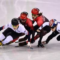 John-Henry Krueger, Canada's Charles Hamelin, Canada's Samuel Girard and South Korea's Seo Yira compete in the men's 1,000m short track speedskating semifinals. | AFP-JIJI