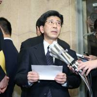 Japan's ruling coalition ready to summon key figure in document scandal to Diet