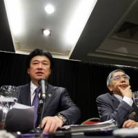 Vice Finance Minister Minoru Kihara and Bank of Japan Gov. Haruhiko Kuroda attend a news conference at the Group of 20 meeting of finance chiefs in Buenos Aires on Tuesday. | REUTERS