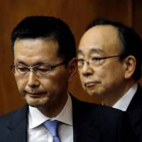 Masazumi Wakatabe (left) and Masayoshi Amamiya, government nominees to become the next Bank of Japan deputy governors, attend a confirmation hearing in the Lower House on Monday. | REUTERS