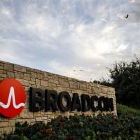 The Broadcom Ltd. logo is seen on a sign at the firm's headquarters in Irvine, California, in November. | BLOOMBERG