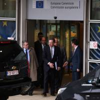 U.S. Trade Representative Robert Lighthizer leaves the European Commission headquarters after a meeting on steel overcapacity, in Brussels Saturday. | REUTERS