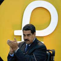 Trump bars U.S. firms and citizens from dealing in Venezuela's new cryptocurrency