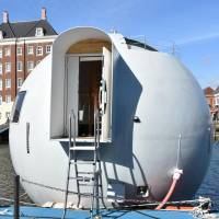 Huis Ten Bosch Co. unveils a floating capsule hotel on Tuesday in Sasebo, Nagasaki Prefecture. | KYODO