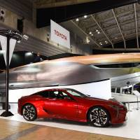 Toyota Motor Corp.'s Lexus Sport Yacht Concept (above) and a Lexus LC 500 vehicle are displayed at the Japan International Boat Show in Yokohama on March 8. | BLOOMBERG