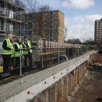 British Prime Minister Theresa May visits a housing development in east London on March 5. | AFP-JIJI